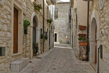 Fototapeta A narrow street among the old houses of Ferrazzano, a medieval village in the Molise region.