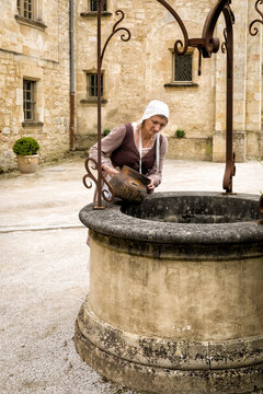 Peasant woman at medieval water well