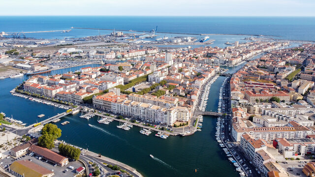 Aerial view of the old town center of Sete in the South of France - Two urbanised islands surrounded with ancient canals between the Mediterranean Sea and the Pond of Thau