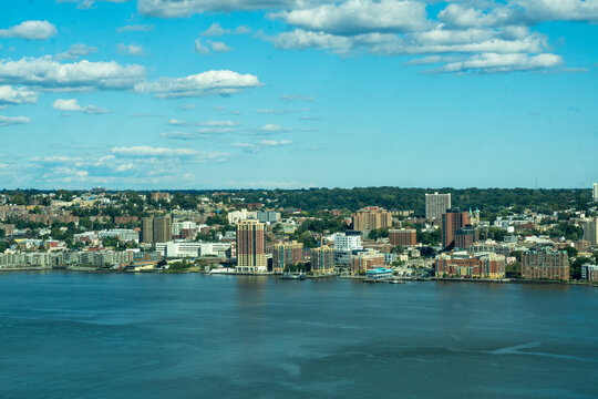 Yonkers, NY / United States - Oct. 6, 2020: a wide landscape view of Yonker's historic waterfront, made up of restaurants, shops and residential buildings.