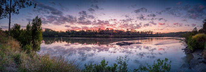 Panoramic Riverside Sunrise with Reflected Cloudscape