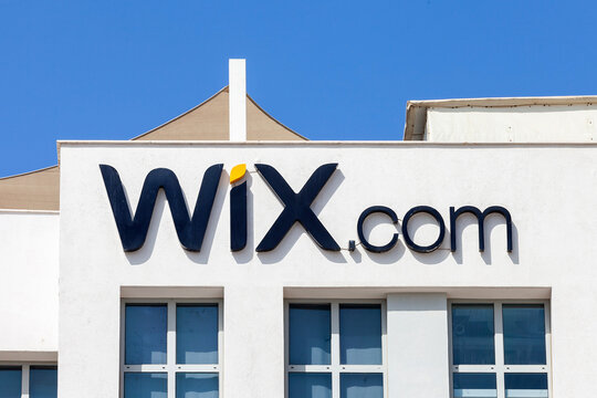 Wix logo on a company building with blue sky in the background.
