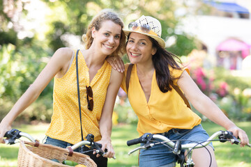 two young women cycling together
