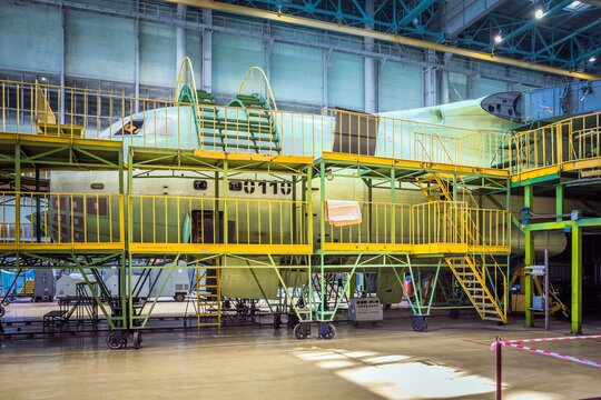 An airplane assembling in a plant.