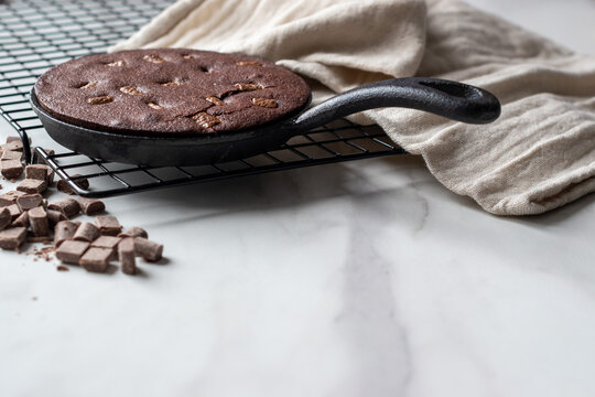chocolate brownie cooked in a cast iron skillet with space for text