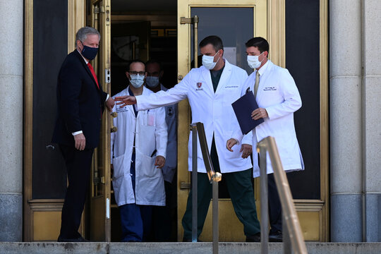 U.S. Navy Commander Dr. Sean Conley, the White House physician, arrives to speak about U.S. President Donald Trump's health, in Bethesda