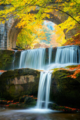 Fall Autumn landscape - river waterfall in colorful autumn forest