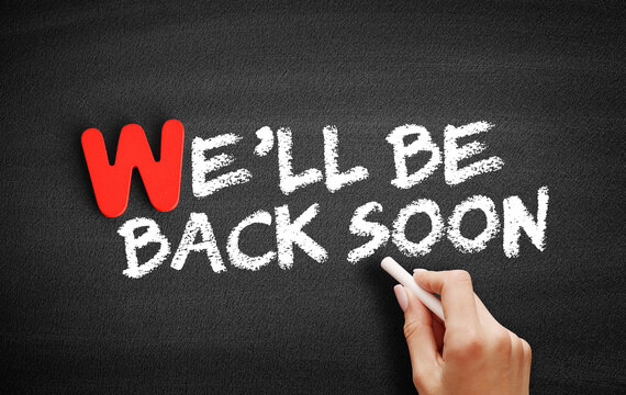 We'll Be Back Soon text on blackboard, business concept background