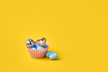 Muffin with easter blue eggs and bird. Springtime concept. Creative conceptual photo