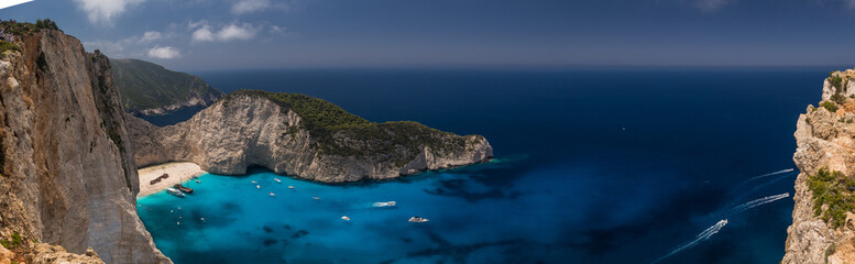 Panorama of Amazing Navagio Beach in Zakynthos Island with Ship Wreck beach and Navagio bay visible. The most famous natural landmark of Zakynthos, Greek island in the Ionian Sea .
