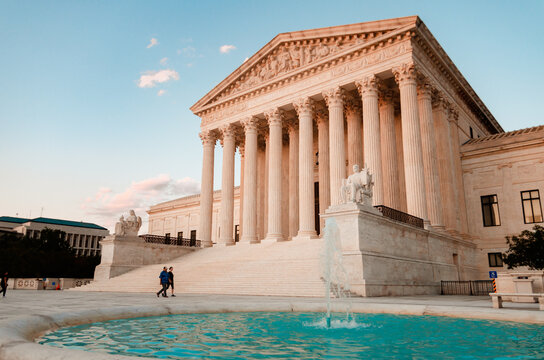 A couple walks by the US Supreme Court