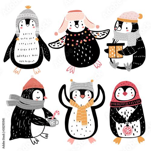 Wall mural Cute penguins celebrating Christmas eve having fun, drinking tea. Funny characters.