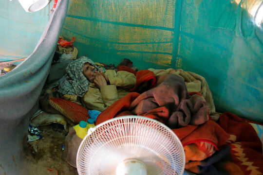 Man sleeps inside a tent at a camp for internally displaced people (IDPs) in Marib