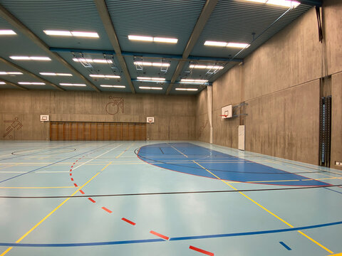 Interior of empty modern gymnasium - basketball, floorball, badminton, velleyball, soccer indoor sport courts