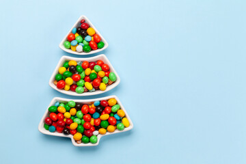 Christmas greeting card with fir tree shaped sweets