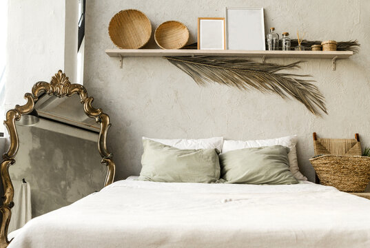Minimal home interior bedroom design in boho style. Pillows, blanket and decorations.