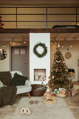 Modern interior design concept. Comfortable cozy living room decorated with Christmas tree with...