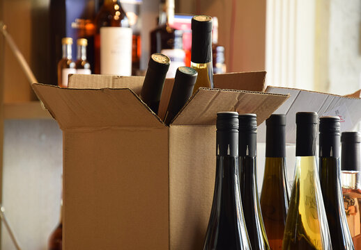 The wine is put in a box and ready for home delivery