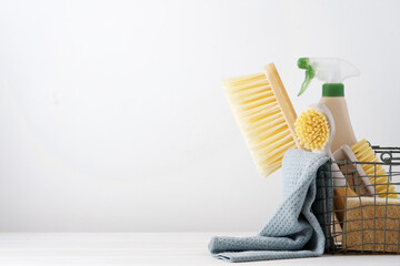 Obraz Eco brushes, sponges and rag in cleaning basket. Cleaner concept on white background - fototapety do salonu