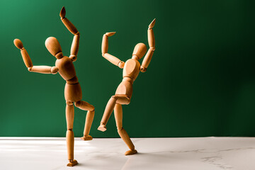 The concept of celebrating the Jewish holiday Simchat Torah. Two wooden men are dancing