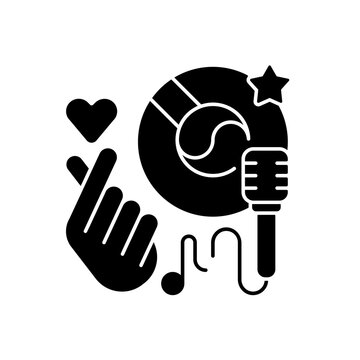 K pop black glyph icon. Musical genres. Microphone with vinyl. Giving love hand. Music loving. Singing songs. Favourite hobby. Silhouette symbol on white space. Vector isolated illustration