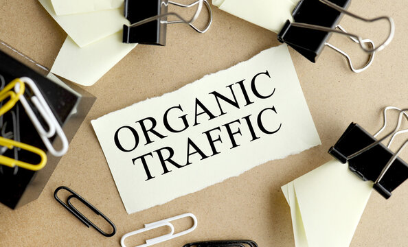 Organic traffic. text on yellow paper near paper clips on table