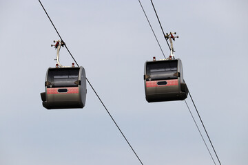 Cable car cabins on sky background. Ropeway gondola close up
