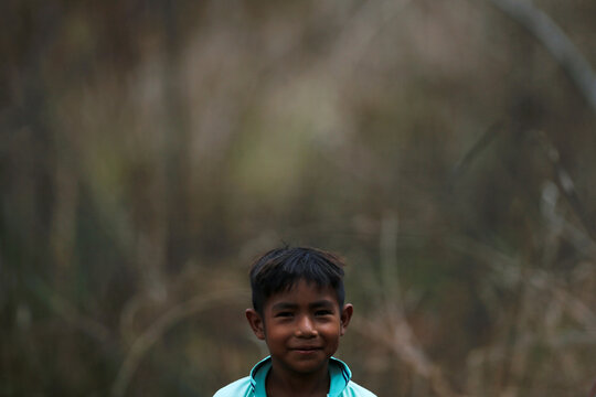 A Child from the Guajajara indigenous ethnic group looks on, in Grajau