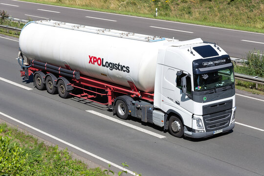 WIEHL, GERMANY - JUNE 25, 2020: Volvo FH truck with XPO Logistics silo trailer on motorway.