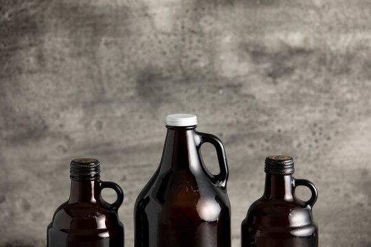 beer growler bottles for craft beer with white space for a copy over a grey background
