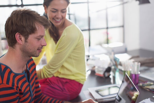Couple working from home at laptop