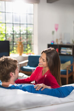 Couple talking on sofa
