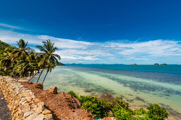 beach on Koh Samui in Thailand, paradise, sunny beach, coconuts and palm trees, sunbathing and swimming in the sea, blue ocean and sky, travel to the resort, relaxation and enjoyment Wall mural