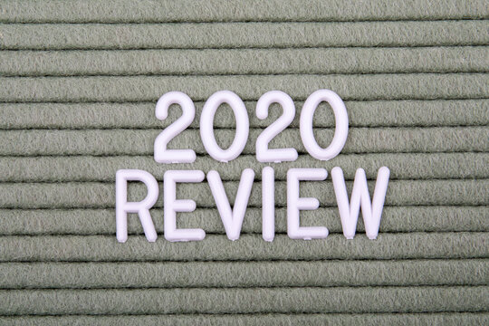 2020 REVIEW. White letters of the alphabet on a green background