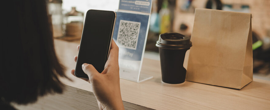 Panoramic banner. customer using digital mobile phone scan QR code pay for buying coffee in cafe coffee shop, restaurant, digital payment, online shopping, takeaway food, internet technology concept