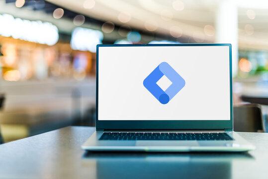 Laptop computer displaying logo of Google Tag Manager