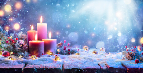 Fototapeta Advent - Four Purple Candles With Christmas Ornament In Shiny Night obraz
