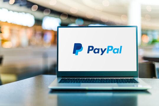 Laptop computer displaying logo of PayPal