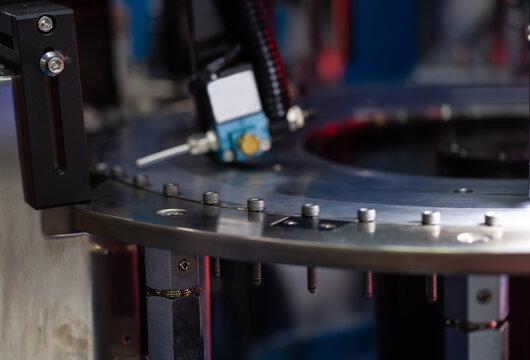 Linear optical screw sorting machine. Screw / bolt / nut. Industrial manufacturing machinery