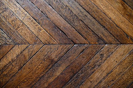 Old wooden diagonal parquet. Background texture.