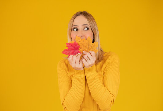 autumn woman in studio over yellow background