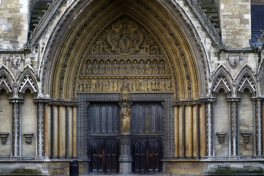 Stone carvings of figures are seen at the portal outside of Westminster Abbey in London
