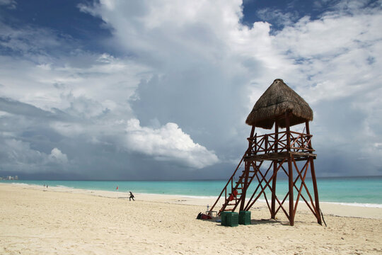 A general view shows an almost empty beach ahead of the arrival of Hurricane Delta, in Cancun