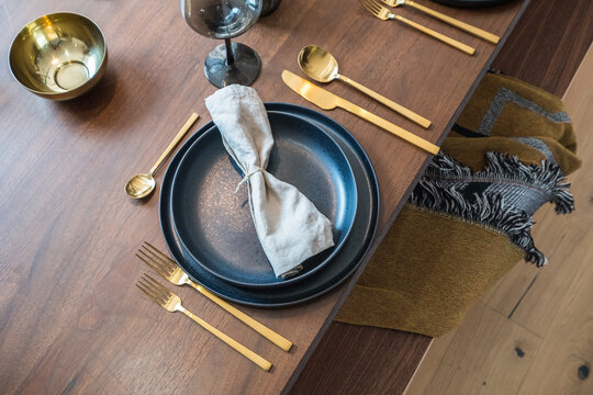 rustic table setup with brass cutlery
