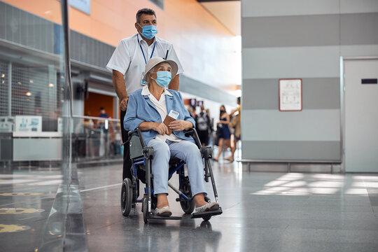 Elderly female passenger being transported in a wheelchair