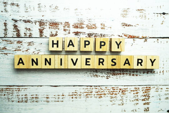 Happy Anniversary alphabet letter with space copy on wooden
