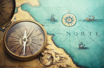 Magnetic old compass on world map.Travel, geography, navigation, tourism and exploration concept background. Treasure Island on the Pirate Map.