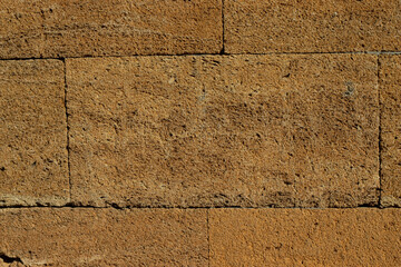 Brown brick wall background. Stone texture backdrop