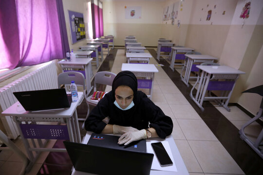 Teacher gives an online lesson to students receiving distance education in Amman