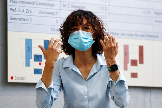 Scientist Emmanuelle Charpentier, director of the Max Planck Institute for Infection Biology in Berlin puts on a protective face mask, after winning the 2020 Nobel Prize in Chemistry for the development of a method for genome editing, in Berlin